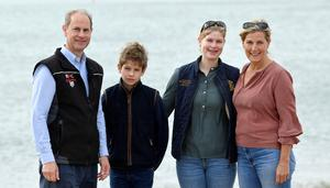 The Earl and Countess of Wessex litter picking with their children in Southsea (Toby Melville/PA)