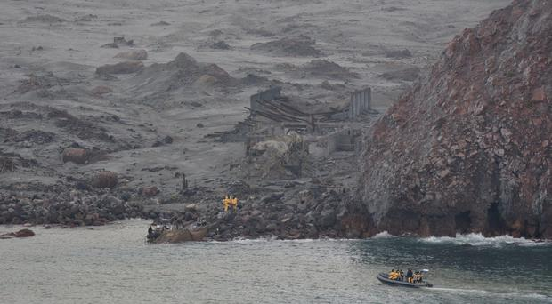 Retrieval teams begin their task amid the eerie landscape of White Island (New Zealand Defence Force handout/PA)
