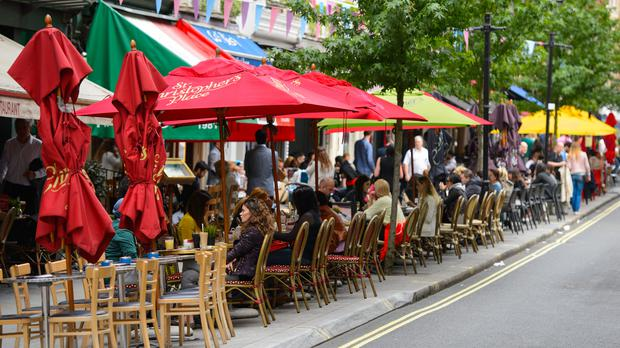 Diners eating outside in central London (Dominic Lipinski/PA)