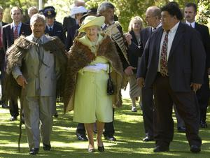 The Queen, wearing her own kiwi feather korowai given to her for her Coronation in 1953, in Christchurch, New Zealand in 2002 (Fiona Hanson/PA)
