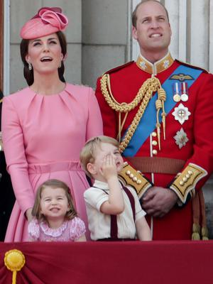 Charlotte and her family watching the flypast (Yui Mok/PA)