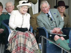Queen Elizabeth and Prince Charles, Prince of Wales, watch the action during the Braemar Highland Games at the weekend