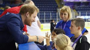 Prince Harry wearing the bracelet that has sparked speculation about a royal romance, during a visit to the National Ice Centre in Nottingham