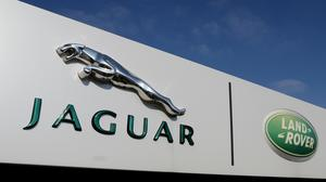 Jaguar Land Rover is to suspend production at its UK plants (Dave Thompson/PA)