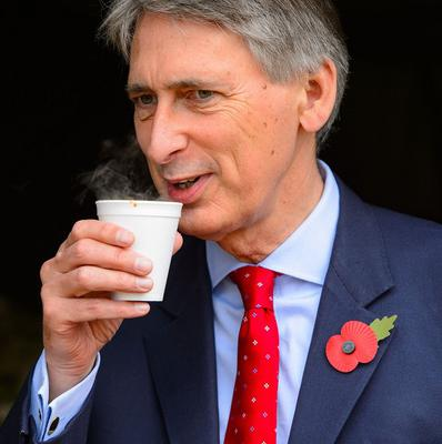 Defence Secretary Philip Hammond drinks a cup of tea during a visit to a London Territorial Army meet and greet event, at Horse Guards Parade, in Westminster, central London.