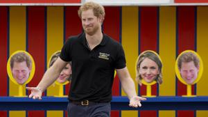 Prince Harry takes part in filming a segment where a photo of him is printed on some of the targets children had to throw balls at for an episode of the Sky Sports 'Game Changers' television show dedicated to the Invictus Games at Lambs Lane Primary School in Spencers Wood, near Reading.