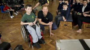 Prince Harry watches a monitor alongside Craig, 10, between segments in the filming of an episode of the Sky Sports 'Game Changers' television show dedicated to the Invictus Games at Lambs Lane Primary School in Spencers Wood, near Reading.