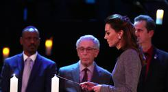The Duchess of Cambridge lights a candle during the UK Holocaust Memorial Day Commemorative Ceremony at Central Hall in Westminster, London (Chris Jackson/PA)