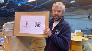 Scott McIntyre helping load the first operating room, split into containers, headed to the Ivory Coast from the charity's Dundee warehouse (KidsOR/PA)