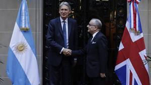Philip Hammond, left, has held talks with Argentinian Foreign Minister Jorge Faurie (Victor R. Caivano/AP)