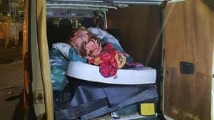 Officers opened the back of the van to find 11 people – including two babies and four toddlers – inside (Central Motorway Police Group/PA)