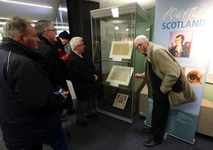 The manuscripts are displayed side-by-side for the first time in many years (Andrew Milligan/PA)