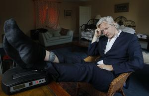 Assange with his ankle security tag at a house near Bungay in June 2011 (Kirsty Wigglesworth/AP)