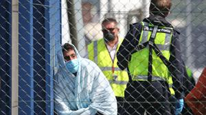 A man thought to be a migrant is processed by Border Force officers (Gareth Fuller/PA)