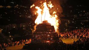 A bonfire in the bogside area of Londonderry, which is traditionally torched on August 15 to mark a Catholic feast day celebrating the assumption of the Virgin Mary into heaven (Niall Carson/PA)
