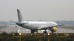 A Vueling plane waits to take off at Gatwick Airport (Philip Toscano/PA)