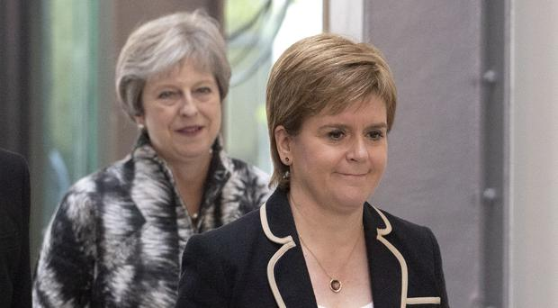 Prime Minister Theresa May and First Minister Nicola Sturgeon (Jane Barlow/PA)