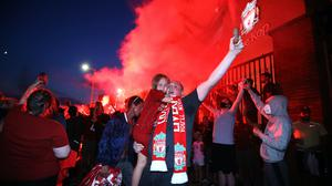 Liverpool fans celebrate outside Anfield (Martin Rickett/PA)