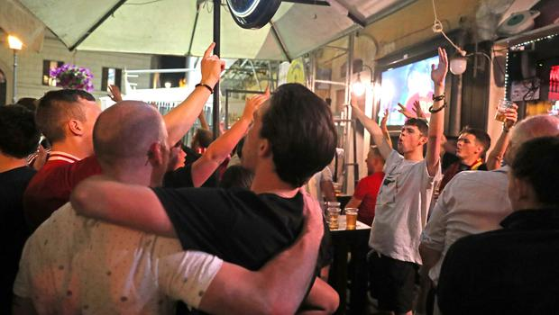 Liverpool fans celebrate the final whistle in a bar in Rome city centre (Steve Parsons/PA)