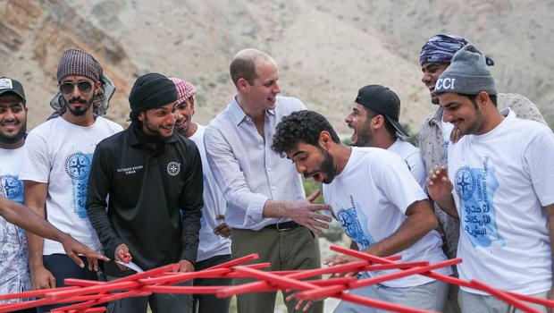 The Duke of Cambridge celebrates helping with the successful building of a bridge during an event with Outward Bound Oman (Andrew Matthews/PA)