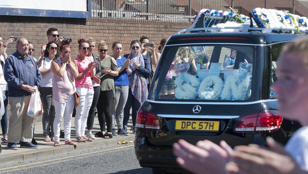 The funeral cortege of Alfie Evans goes past Everton's Goodison Park ground in Liverpool (Andrew Price/PA)