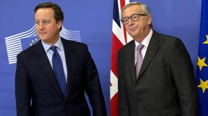David Cameron, left, with European Commission president Jean-Claude Juncker before the EU meeting (AP)