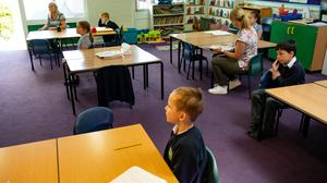 Children of essential workers socially distance whilst in lesson at Kempsey Primary School in Worcester (Jacob KIng/PA)