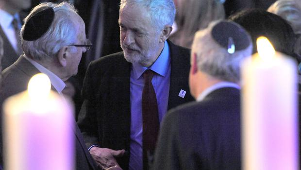 Labour Party leader Jeremy Corbyn (centre) speaks with guests during a Holocaust Memorial Day service (Nick Ansell/PA)