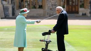 Captain Sir Thomas Moore is knighted by the Queen (Chris Jackson/PA)