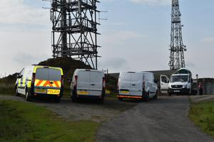 Police vehicles at the scene near the summit of Brown Clee Hill in Shropshire (Matthew Cooper/PA)