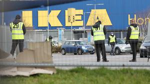 Stewards organise traffic at a Covid-19 test centre for NHS workers which has opened at the Ikea store in Wembley, north-west London (Jonathan Brady/PA)