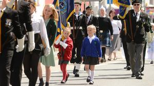 Mollie Stonelake carries the specially-made miniature standard (Royal British Legion/PA)