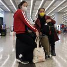 Passengers wear masks to prevent an outbreak of a new coronavirus at a train station in Hong Kong (Kin Cheung/AP)