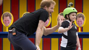 Prince Harry takes part in filming a segment where a photo of him is printed on some of the targets children had to throw balls at for an episode of the Sky Sports Game Changers television show
