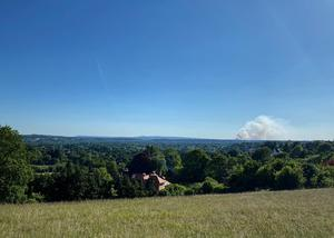 A fire on Thursley Common as seen from 11 miles away at Pewley Down park in Guildford (Sophie Garrett/PA)