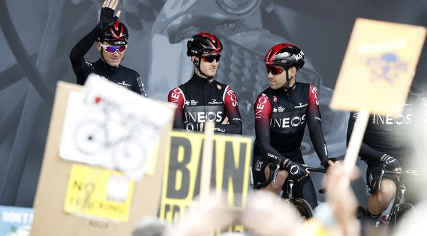 Team INEOS' Chris Froome (left) waves to the crowd before stage one of the Tour de Yorkshire (Bradley Collyer/PA)