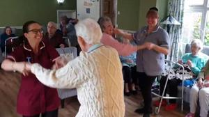 The residents and staff dance along to the tune in the video (Avenue Care Home/Facebook/PA)