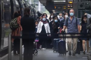 Travellers wearing face masks arrive from Paris to St Pancras on Saturday (Victoria Jones/PA)