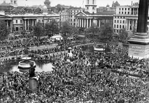Huge crowds gathered in Trafalgar Square on May 8, 1945, to celebrate Victory in Europe Day (PA)