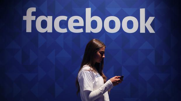 The board will have the ability to overrule Facebook's decisions on content moderation (Niall Carson/PA)
