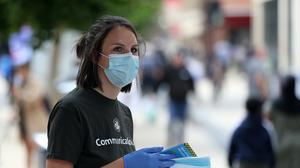 Bristol City Council staff hand out 80,000 face masks in the city centre (Andrew Matthews/PA)