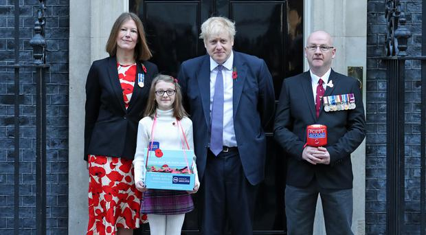 Prime Minister Boris Johnson meets fundraisers for the Royal British Legion and purchases a poppy (Yui Mok/PA)