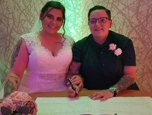 Louise Arnold-Wilson (right) and Jennifer (left) were married at Runcorn Town Hall Registry Office at one minute past midnight (Halton Borough Council/PA)