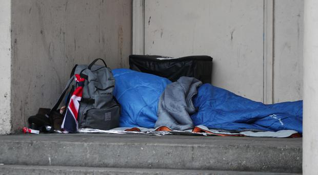 A homeless person sleeping rough in a doorway in Farringdon, London (Yui Mok/PA)