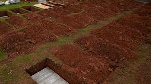 Rows of new graves being prepared at High Wood Cemetery, Nottingham (Jacob King/PA)