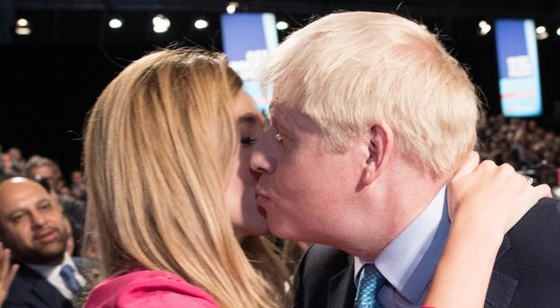 Prime Minister Boris Johnson kisses his partner Carrie Symonds, after delivering his speech during the Conservative Party Conference (Stefan Rousseau/PA)