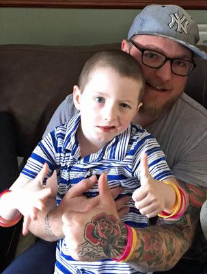 Harry St Ledger with his father Cairan (Brain Tumour Research/PA)