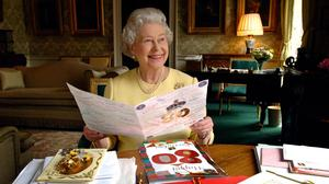Queen Elizabeth reads 80th birthday cards from wellwishers.