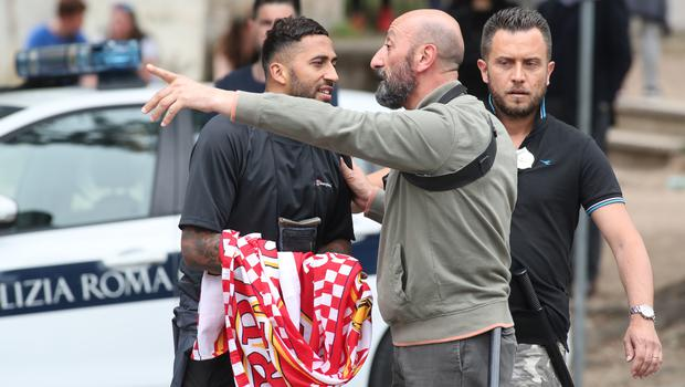 Italian police search Liverpool FC fans (Steve Parsons/PA)