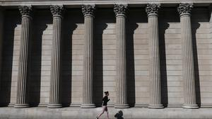 A jogger runs past the Bank of England in the City of London (Yui Mok/PA)